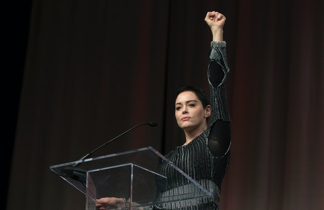 Rose McGowan raises her fist during her opening remarks to the audience at the first national convention of the Women's March in Detroit on Oct. 27, 2017.