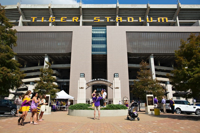 Fans take pictures outside of Louisiana State University's Tiger Stadium in Baton Rouge, Louisiana.