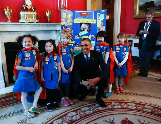 President Barack Obama poses with a group of Girl Scouts at the 2015 White House Science Fair celebrating STEM competition winners from across the country.