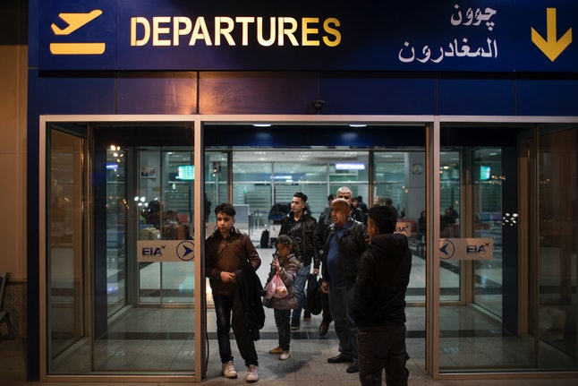 An Iraqi family landed in the United States as a federal court blocked a travel ban that would have kept them out of the country for 120 days.