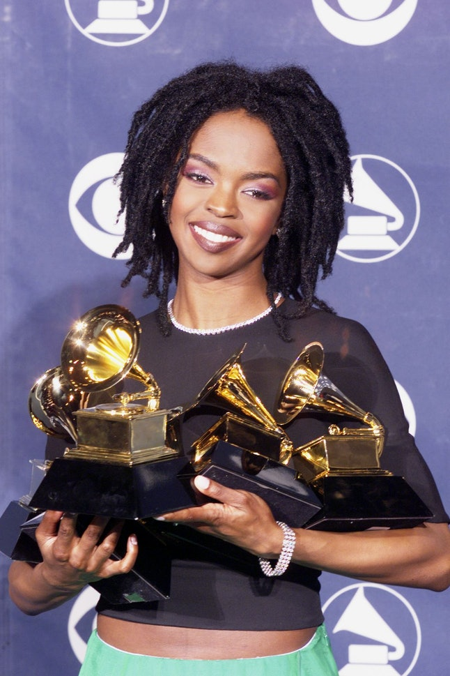 Singer Lauryn Hill with her five Grammy awards including Album of the Year for 'The Miseducation of Lauryn Hill,' at the 41st Annual Grammy Awards in Los Angeles, Feb. 24, 1999.