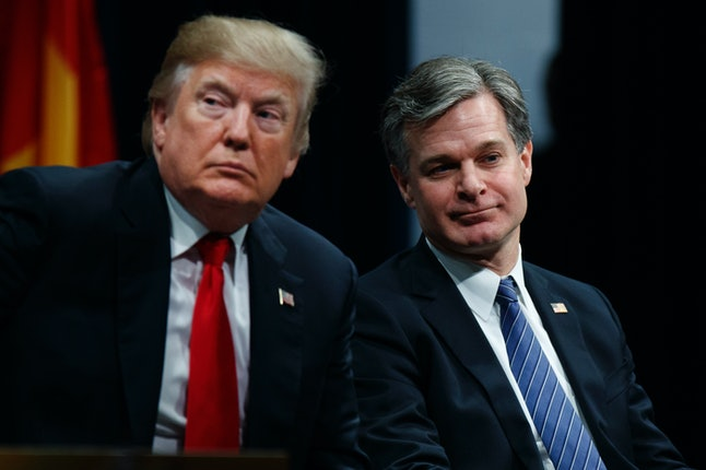 President Donald Trump and FBI Director Christopher Wray attend the FBI National Academy graduation ceremony in December.