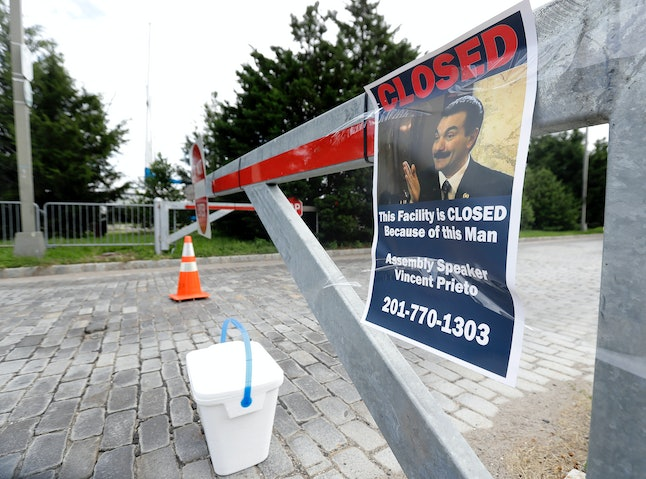 A sign hangs from a barricade Sunday at the entrance to Liberty State Park in Jersey City, New Jersey. The park remains closed due to a government shutdown.