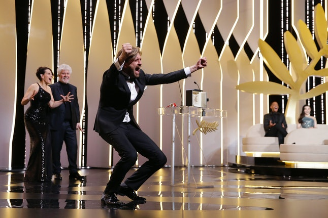 Director Ruben Ostlund celebrates winning the Palme d'Or award for his film 'The Square'
