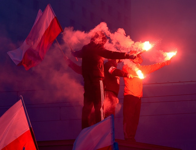 Demonstrators burn flares and wave Polish flags during the annual march to commemorate Poland's National Independence Day in Warsaw on Nov. 11.