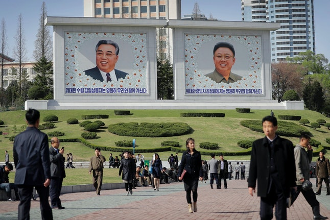 Portraits of Kim Il-Sung and Kim Jong Il hang in Downtown Pyongyang.