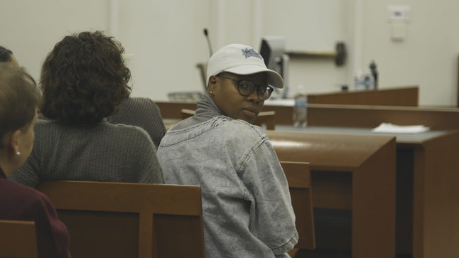 Glo Merriweather is seated in court for their Nov. 28 arraignment.