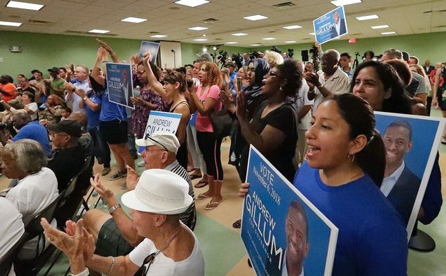 Supporters clap and cheer for Florida Democratic gubernatorial candidate Andrew Gillum on Monday after Puerto Rico Gov. Ricardo Rosselló endorsed him at a campaign rally in Kissimmee, Florida.