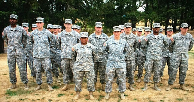 Jozlyn McCaw, left of center, poses with the platoon she leads at Joint Base Lewis-McChord in Washington state.