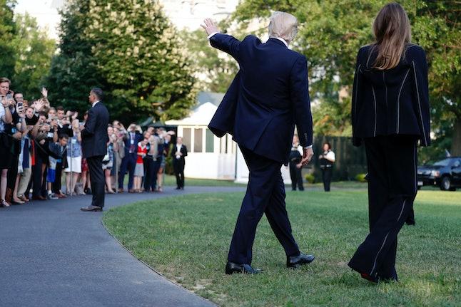 Melania Trump and her husband walk to Marine One