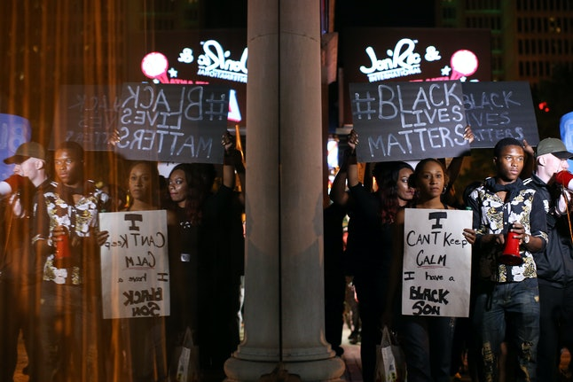 Protestors march through downtown Atlanta, in response to the shooting deaths of black men in Tulsa, Oklahoma, and Charlotte, North Carolina.