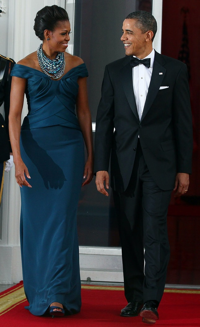 Barack Obama and Michelle Obama wait before a state dinner in March 2012.