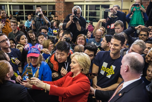 Hillary Clinton takes selfies with supporters at a recent campaign stop in West Des Moines, Iowa.