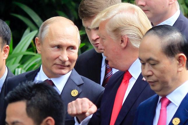 President Donald Trump talks with Russian President Vladimir Putin during the Asia-Pacific Economic Cooperation summit in Vietnam Saturday.