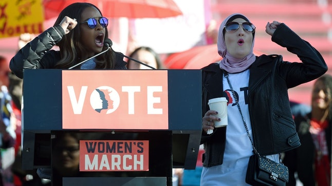 Women's March co-chairs Tamika Mallory, left, and Linda Sarsour speak during the Women's March Power to the Polls voter registration tour launch in January.