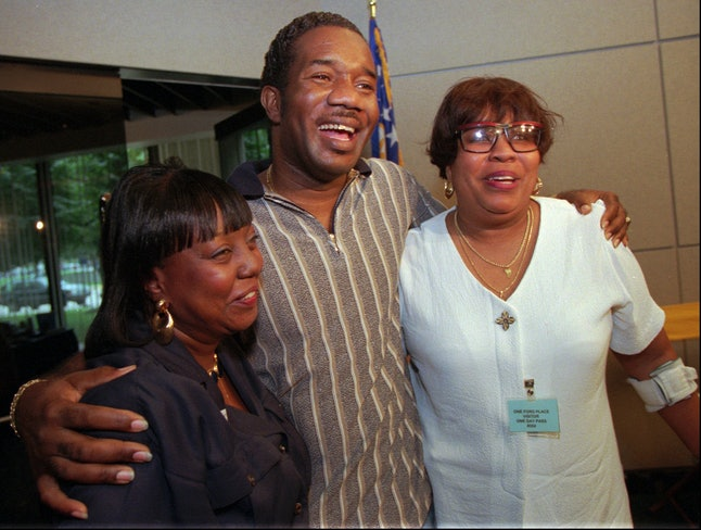 Heart transplant recipient James Lovett Jr., 38, of Detroit, embraces Edith Lee-Payne, left, mother of his heart donor, Antoine Lee, and his mother, Evelyn Walker, during a news conference in Detroit Wednesday, Sept. 10, l997.