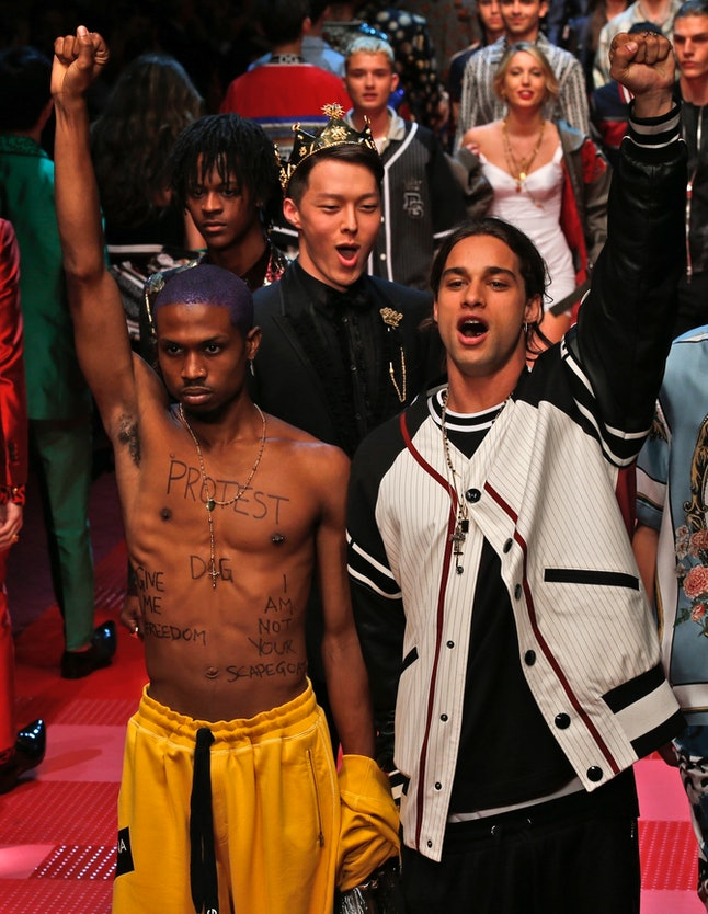 Raury (left) during his protest at the Dolce & Gabbana show in Milan