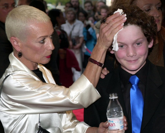 Anton Yelchin's mother wipes his forehead at a red carpet event in 2001.