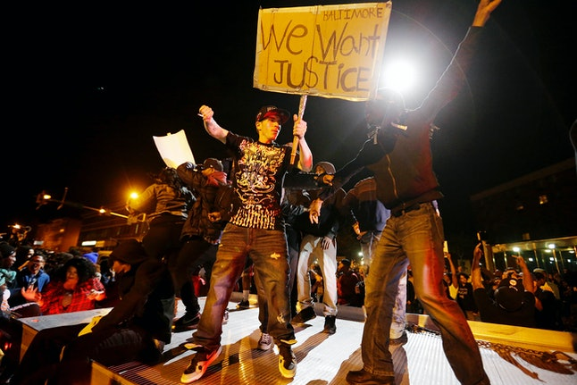 Protestors demonstrate after a Baltimore curfew is imposed following the death of 25-year-old Freddie Gray on May 1, 2015.