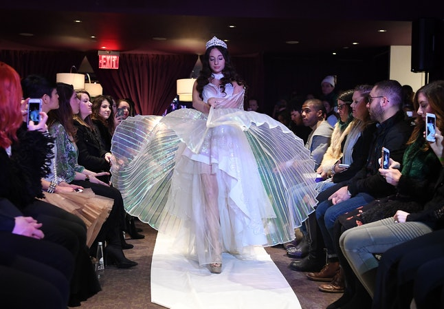 A model walks in the #MeToo fashion show at NYFW.