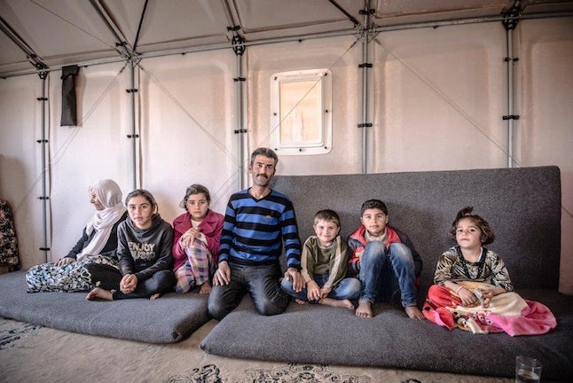 A family in a Better Shelter prototypw in Kawergosk refugee camp, Iraq