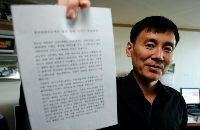 Jung holds up a letter her wrote for North Korean prisoners for the 'Associated Press' cameras on Oct. 29, 2008.
