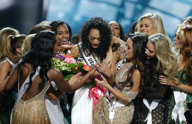 McCullough being congratulated by the other contestants after winning the crown