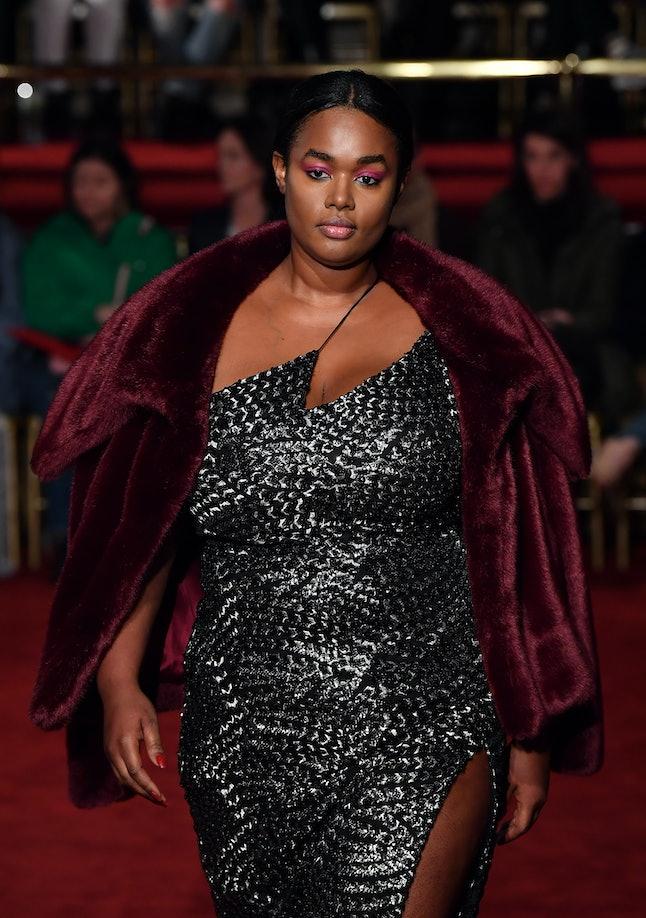 Model Precious Lee walking for Christian Siriano fall/winter at NYFW