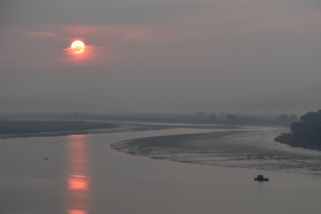 The sun rises over North Korea and the Yalu River which forms the border between China and North Korea, as seen from Dandong, China on Sept. 5, 2017. Thousands of North Koreans swam through the Yalu River over the years to escape their home country.