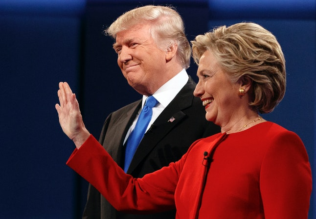 Donald Trump and Hillary Clinton smile as their supporters clap following the first presidential debate at Hofstra University in New York.