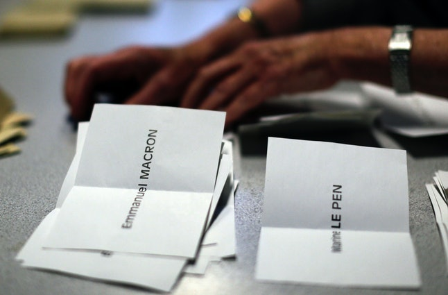 Ballots are counted by volunteers during the French presidential election on Sunday.