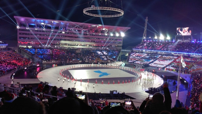 North and South Korea enter the Pyeongchang Olympic Stadium together during the opening ceremony on Feb. 9, while an overhead projector display their unified flag depicting the entire Korean peninsula as one.