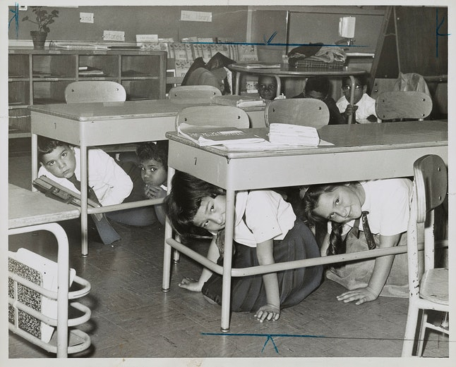 Students duck and cover in a Brooklyn elementary school