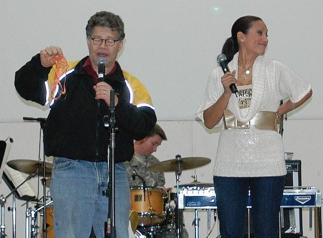 Al Franken and Leeann Tweeden perform a comic skit in Mosul, Iraq, in 2006.