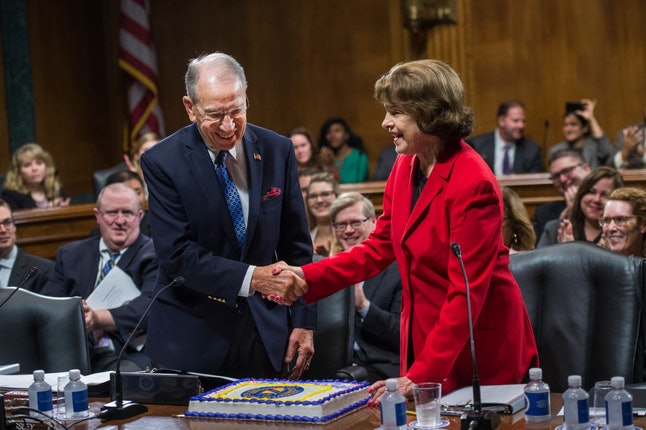 Sen. Dianne Feinstein (D-Cali.), at right, presents Sen. Chuck Grassley (R-Iowa) with a cake to celebrate his birthday and wedding anniversary.