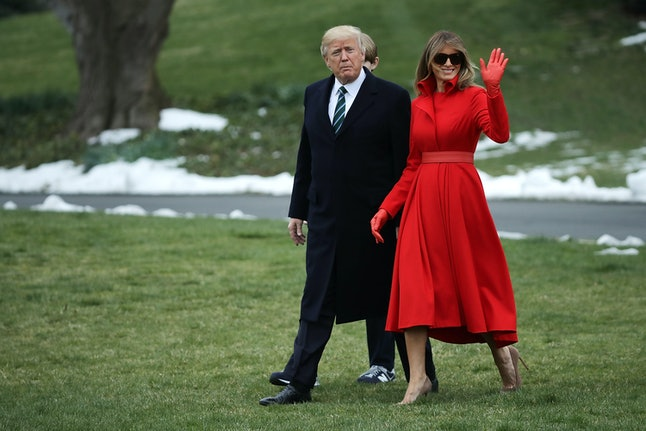 Melania Trump (right) leaving the White House