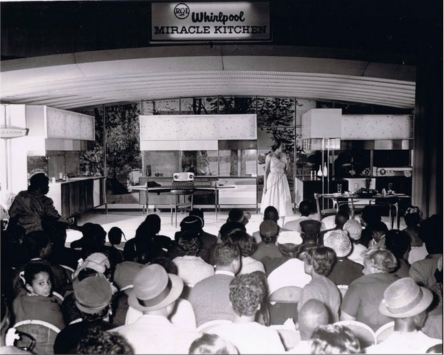 An audience listening to a demo of the modern kitchen at the Chicago Housewares show of 1956