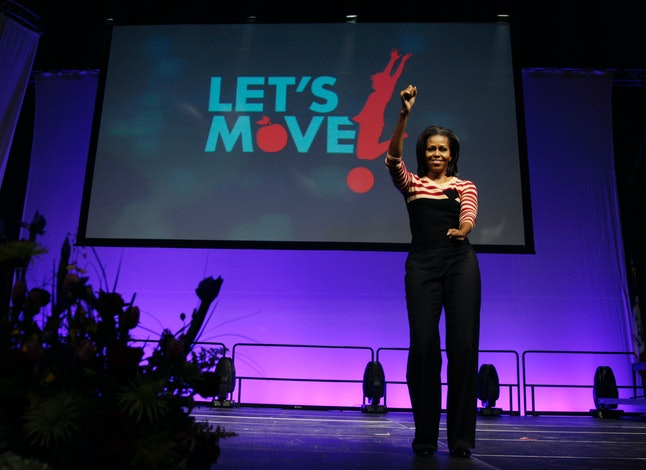 Former first lady Michelle Obama gets ready to dance during a Lets Move! event at a school on Feb. 9, 2012, in Des Moines, Iowa.