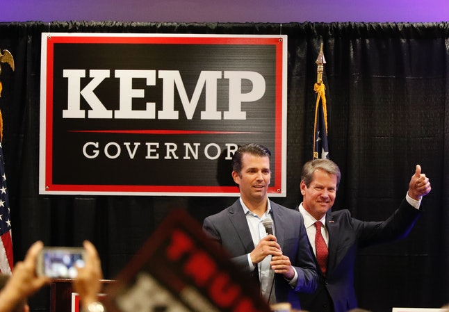 Donald Trump Jr. speaks to the crowd during a campaign event of Republican nominee for Georgia Gov. Brian Kemp, right, on Tuesday, Oct. 9, in Athens, Georgia.