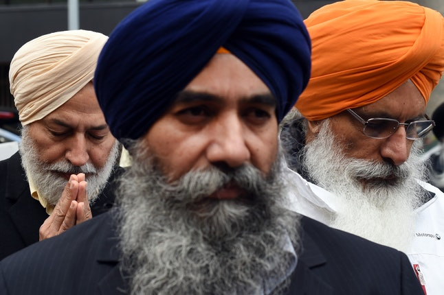 Sikh American men gather at a protest in New York in 2014.