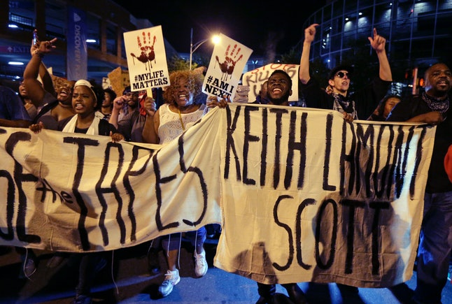 Protesters shout as they march in the streets of Charlotte, North Carlina, to protest the fatal police shooting of Keith Lamont Scott.