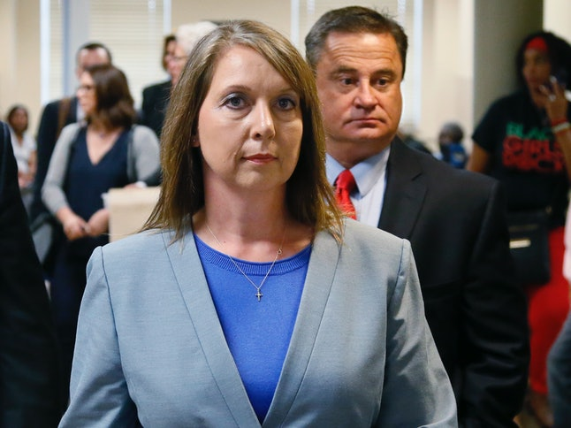 Betty Shelby leaves the courtroom with her husband, Dave Shelby, right, after the jury in her case began deliberations in Tulsa, Oklahoma, Wednesday, May 17, 2017.