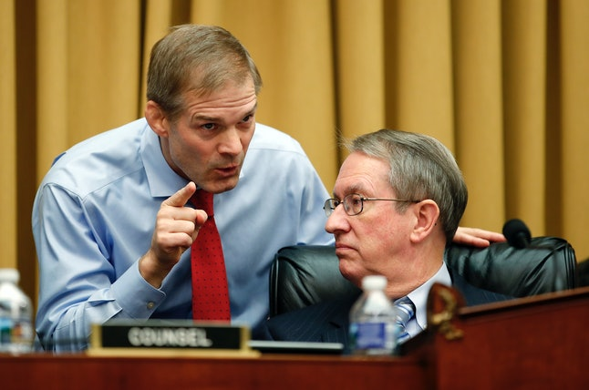 House Judiciary Committee Chairman Bob Goodlatte and Rep. Jim Jordan (R-Ohio) chat during a hearing with FBI Director Christopher Wray on Thursday.