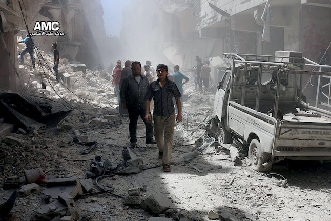 In this July 26 photo, citizens inspect damage following an airstrike in Aleppo.