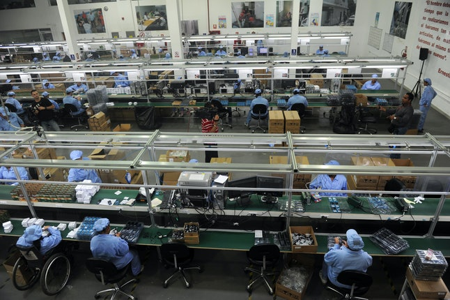 Workers assemble smart phones made in China.