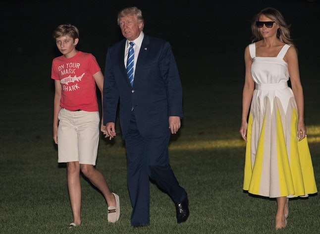 Melania Trump (far right) with her husband and son, arriving back at the White House