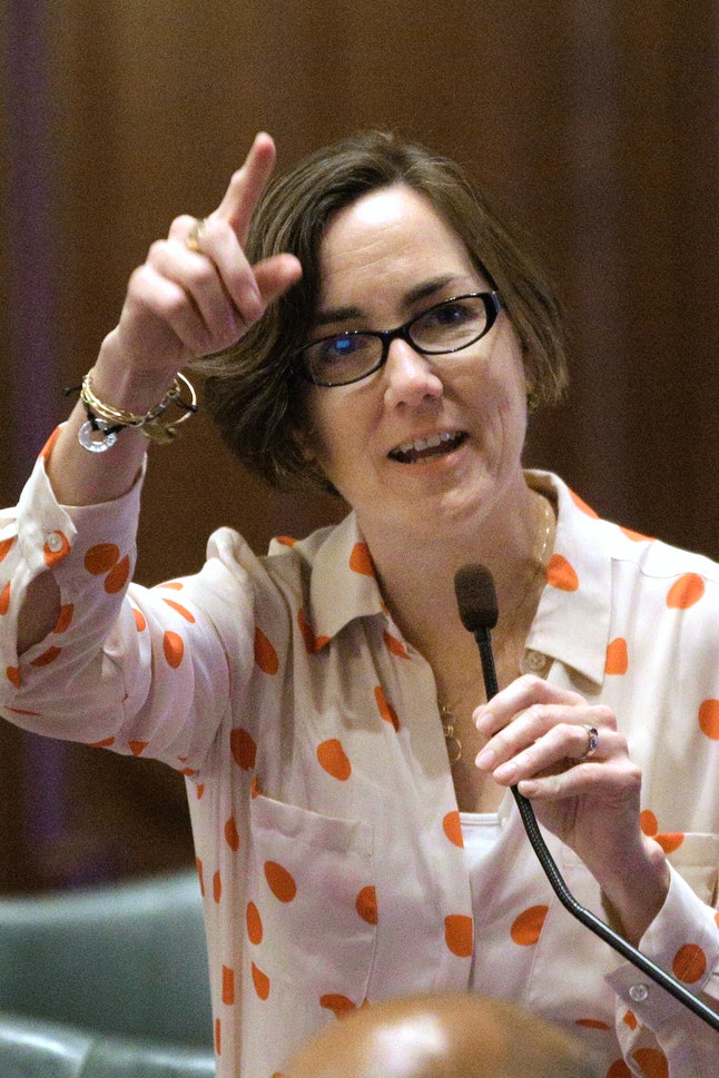 Kelly Cassidy speaks to lawmakers on the House floor during a session at the Illinois State Capitol.