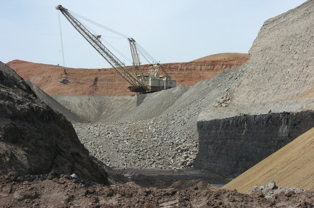 A dragline excavator moves rocks above a coal seam at the Spring Creek Mine in Decker, Montana.