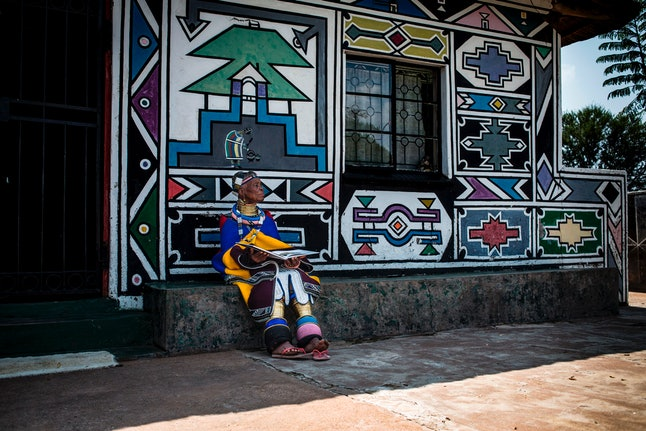 South African artist Esther Mahlangu, 81, poses at her home in Mabhoko Village, Siyabuswa, Mpumalanga on March 6, 2017.