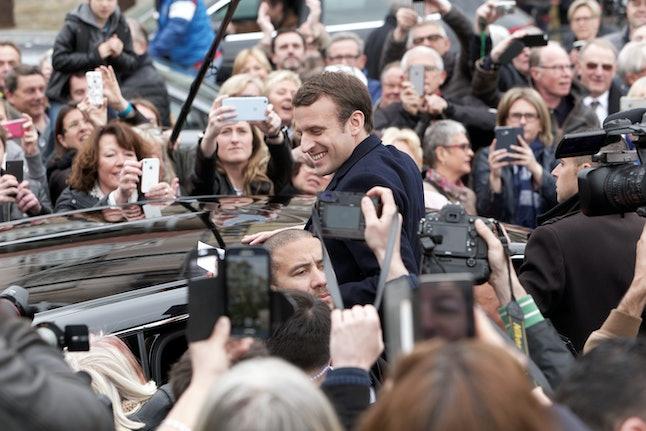 Emmanuel Macron departs his polling station on April 23.